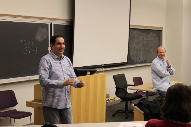 Monty Sharma, left, managing director of Mass DiGI, and Timothy Loew, executive director of Mass DiGI, speak with Northeastern students.