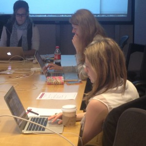 Women learning CSS at the Women's Coding Collective
