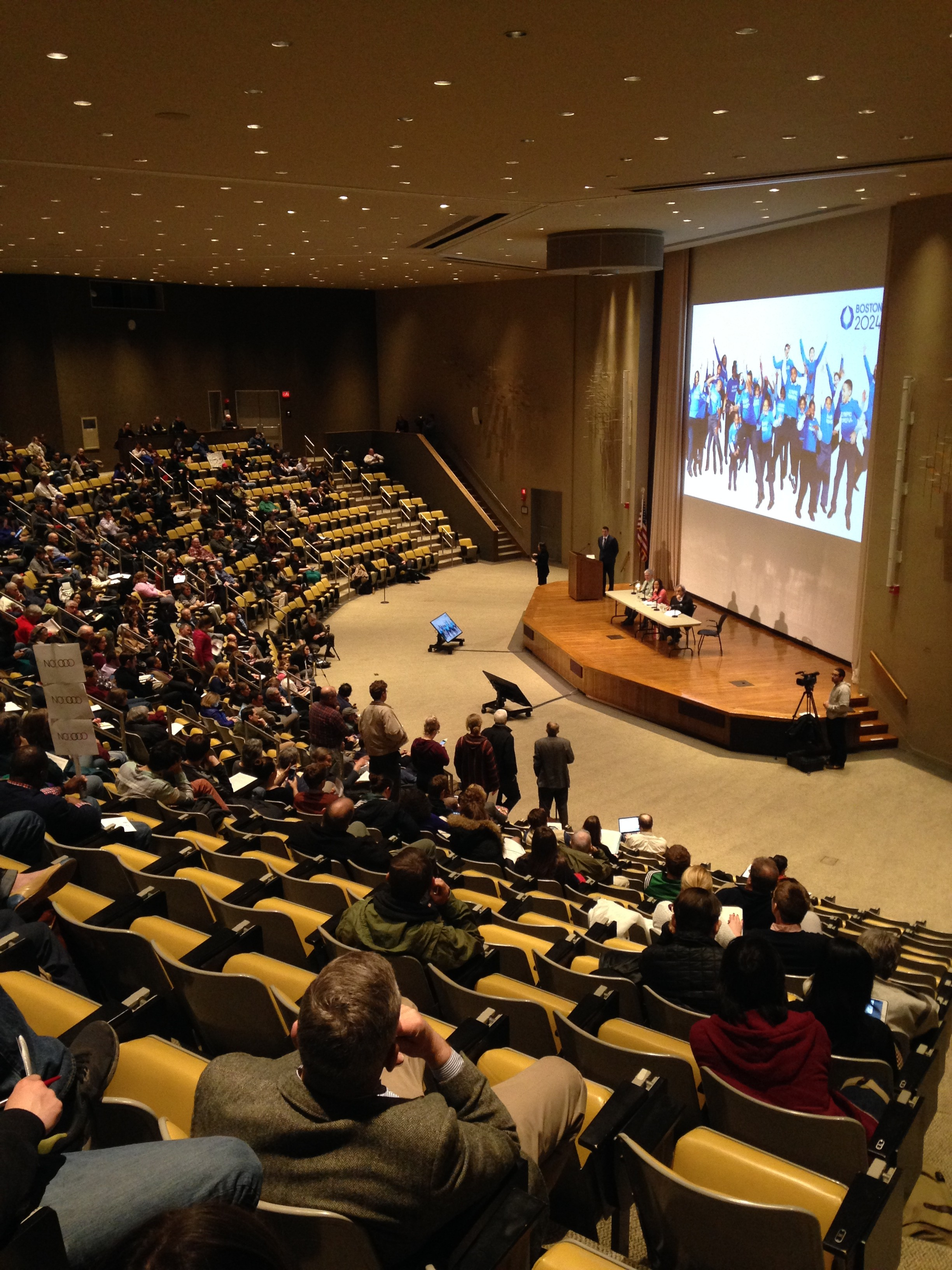 Boston residents gather at a Boston2024 community meeting at Harvard Business School