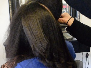 Woman getting her hair straighten after Keratin treatment at Hair Salon Monet.