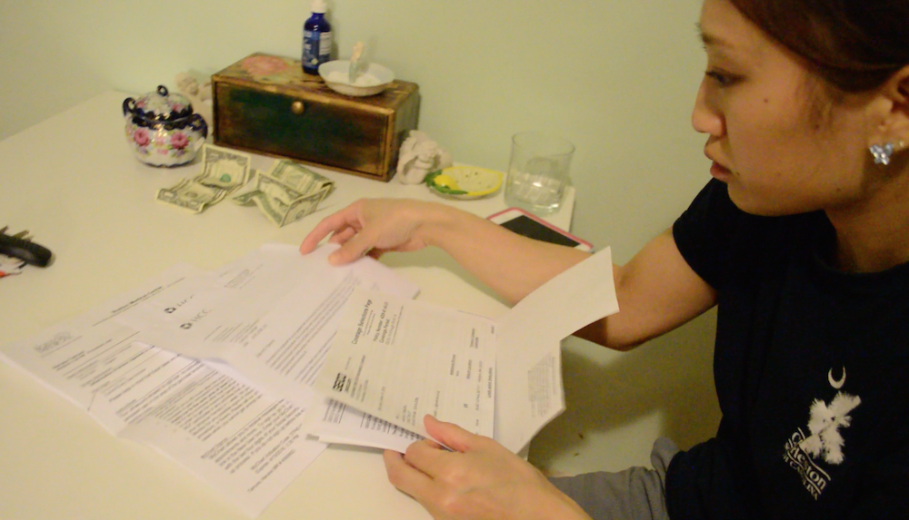 Haruka Tamura receives bills from the hospital and doctors' visits while on recovery without pay. Photo by Shaz Sajadi