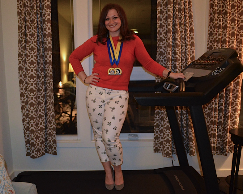 Aubrey Podell poses on her treadmill, with her two Boston Marathon completion medals, in her home in Chelsea, Mass. on April 6, 2016. Photo by Alexandra Prim.